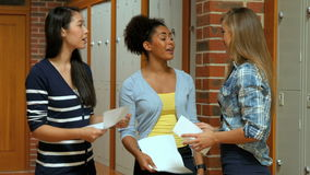 Happy students opening together their result. In college stock footage
