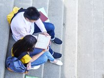 Happy Students Outdoor With Books stock image