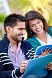 Happy students outdoors Royalty Free Stock Photo