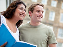 Happy students outdoors Stock Image