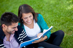 Happy students outdoors Stock Images