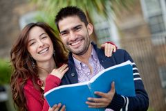 Happy students outdoors Stock Photography