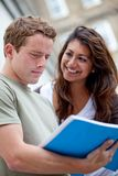 Happy students outdoors Royalty Free Stock Images