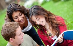 Happy students outdoors Stock Photo