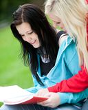 Happy students outdoors Royalty Free Stock Image