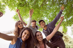 Happy students posing and smiling outside Royalty Free Stock Photography