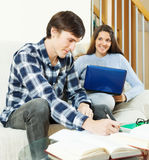 Happy students preparing for examinations. At home royalty free stock photos