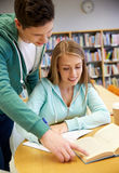 Happy students preparing to exams in library Royalty Free Stock Photo