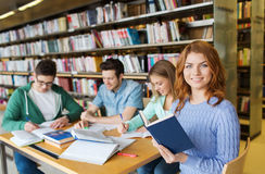 Happy students reading books in library Royalty Free Stock Image