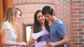Happy students receiving a good news Stock Image