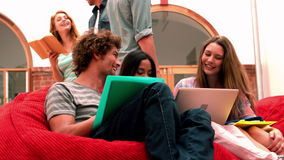 Happy students relaxing in common room stock video