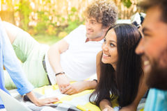Happy students resting in campus Royalty Free Stock Photo