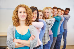Happy students in a row royalty free stock photo