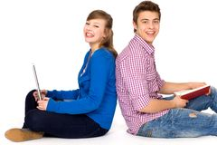 Happy students sitting Royalty Free Stock Image