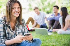 Happy students sitting outside on campus Royalty Free Stock Images