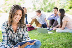 Happy students sitting outside on campus Royalty Free Stock Photography