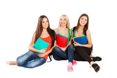 Happy students sitting together with fun, while Royalty Free Stock Image