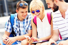 Happy students with smartphone Stock Photo