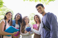 Happy students smiling at camera outside on campus Royalty Free Stock Photos