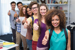 Happy students smiling at camera together Royalty Free Stock Images