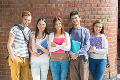 Happy students smiling at camera Royalty Free Stock Images