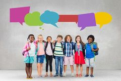 Happy students with speech bubble against grey background stock image