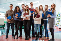 Happy students standing in classroom together Stock Photography