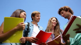 Happy students standing outside chatting stock footage