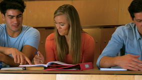 Happy students studying in library stock footage
