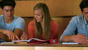 Happy students studying in library stock video