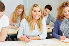 Happy students taking notes Royalty Free Stock Images