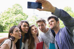 Happy students taking a selfie outside on campus Stock Image
