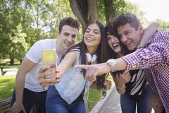 Happy students taking selfie. Portrait of a happy students in the park, outdoors Stock Images