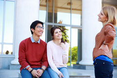 Happy students talking Royalty Free Stock Photo
