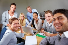 Happy students with teacher. In university class royalty free stock photography
