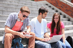 Happy students using digital tablet Royalty Free Stock Photo