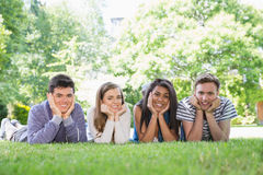 Happy students using laptop outside Royalty Free Stock Photography