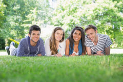 Happy students using laptop outside. At the university Royalty Free Stock Photo