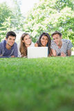 Happy students using laptop outside. At the university Royalty Free Stock Photos