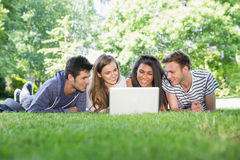 Happy students using laptop outside. At the university Royalty Free Stock Photography