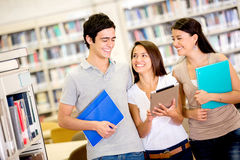 Happy students using a tablet computer Stock Photo