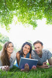 Happy students using tablet pc outside Royalty Free Stock Photos
