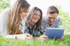 Happy students using tablet pc outside Stock Photos
