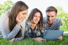 Happy students using tablet pc outside Stock Photography
