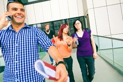 Happy Students Walking Out Of College. Group of happy students walking out of college Stock Photo