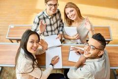 Happy Students Waving at Camera royalty free stock photos