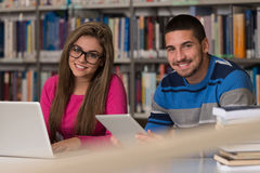 Happy Students Working With Laptop In Library Royalty Free Stock Photography