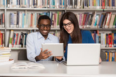 Happy Students Working With Laptop In Library Stock Images