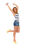 Happy studnet pass all exams and go for a holiday. Summer girl dancing on one leg. Full length studio shot isolated on white Royalty Free Stock Photo