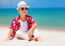 Happy stylish boy enjoying life on tropical beach Royalty Free Stock Photography